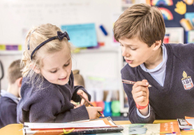 Melbourne Grammar School boy and girl learning together