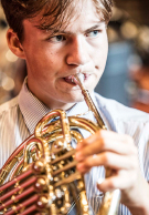 Melbourne Grammar School boy playing french horn