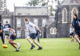 Melbourne Grammar School boys playing sport on oval